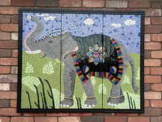 Mosaic elephant in three panels measuring 127cm wide x 103cm high overall.