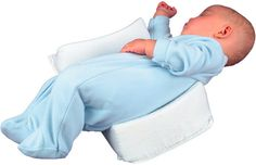 baby sleep positioner: keeps them from choking on spit up and prevents flat head