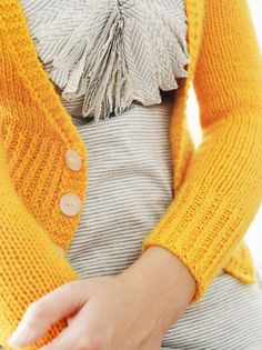 yellow sweater. I want to see the rest of this shirt.