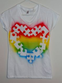 Autism Awareness Tee shirt Puzzle piece by SundayBestClothingCo. Could be a super cute DIY with puzzle pieces and some fabric spray paint.