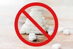 Picture of a restricted sign over some sugar cubes.