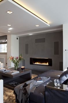 Love the fireplace and combo of grey, beige, black and white!