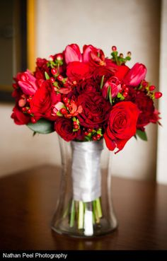 Red-bridal-bouquet.  Flowers of Charlotte loves this!  Find us at www.charlotteweddingflorist.com