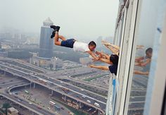 http://www.petapixel.com/2010/06/28/the-jaw-dropping-gravity-defying-photography-of-li-wei/