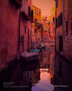Motorboats Docked in a Venice Canal by charleswbaileyjr. @go4fotos