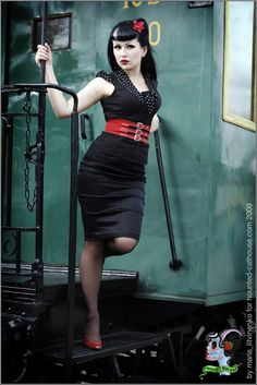 Lonesome train by lady vampyrica  Rockabilly gothic pinup in black dress with white polka dots standing pose