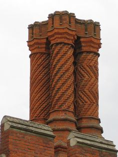 Tudor chimney stacks were often highly decorated to announce the adoption of the new 'technology' - enclosed fireplaces.