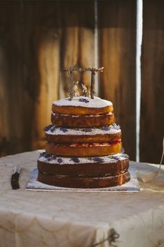 Rustic naked cake: http://www.stylemepretty.com/canada-weddings/ontario/2015/01/20/rustic-elegant-ontario-barn-wedding/ | Photography: Catherine Mombourquette - http://thatdragonflysmiled.com/
