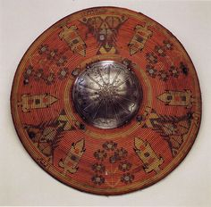 The sort of shields used in the 13th century would have probably been similar to this 17th century Ottoman cane shield: