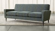 Torino's exaggerated arm and crisp tailoring angle the casual living room in mid-century design. l #homedecor