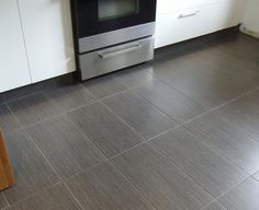 Wood grain tile - In today's home decor, wood and tile floors remain the two most popular flooring decoration materials Concrete Kitchen Floor, Grey Kitchen Floor, Best Flooring For Kitchen, Kitchen Tiles, Gray Floor, Floors Kitchen, Kitchen Reno, Grey Wood Floors, Wood Tile Floors