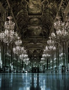 Paris Opera House with its giant chandeliers.