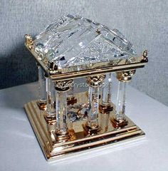 """Swarovski code numbers:   243 446 / 243446 / 9461 000 007  This retired Swarovski Crystal Moments Greek Temple is 1 ¾"""" (44mm) tall and was part of the """"Journeys"""" theme.    Size:   1 3/4  (44mm) tall Designer:   Team Introduced:   2000 Retired:   2003"""