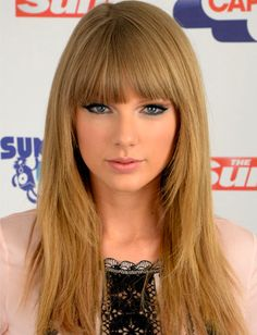 Taylor Swift's hair color, blunt bangs and face framing layers.