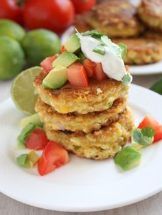 Jalapeno Corn Cakes topped with avocado, lime, and sour cream