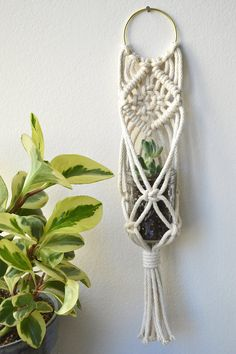 Macrame Plant Hanger handmade in Chicago. This is the perfect plant hanger for any small succulent, votive candle or even an air plant. The design has a flat back so it perfectly lays on the wall with just a nail or hook. Hang in the kitchen, living room or even a pretty powder room. Mat