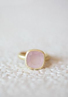 "Light Of My Life Indie Pink Stone Ring 44.99 at shopruche.com. Beautiful and understated, this 18k gold plated ring is perfected with a charming textured band and a light pink stone for light catching shimmer.Pendant: 0.5"" diameter"