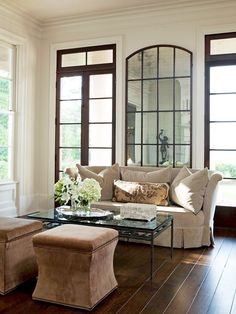 A Statement Mirror in a Traditional Living Room