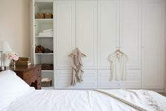 Maple & Gray Wardrobes - built in closets and drawers in the bedroom.