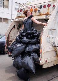 The Garbage Queen, in her Garbage dress? OMG! nice float..LOL