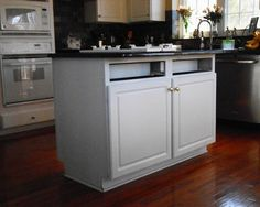 Enchanting Unique Granite Applied on White Cabinets: Marvelous Traditional Kitchen Design Applied Small Kitchen Island And Black Marble Counetrtop Use White Kitchen Cabinet ~ CATALYZE Kitchen Inspiration