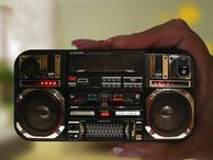 Boombox iPhone case styles up speakerphone situations While the days of the boombox are behind us, one case maker lets the loud spirit and flashy design of the device live on in a decorative iPhone cover.
