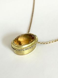 This golden radiant sunshine pendant features a oval citrine surrounded by diamonds and set in 14 yellow gold. Citrine Pendant, Higher Design, Sunshine, Diamonds, Gold Necklace, Yellow, Jewelry, Bijoux, Diamond