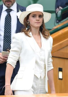Emma Watson attends the Women's Finals at Wimbledon in a suit from the Ralph Lauren Collection archive.