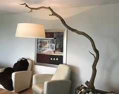 Floor lamp of old weathered Oak branch on black natural stone plate.