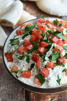 Garlicky Feta Dip. This creamy, tangy dip goes great with pita and is easy to whip together as a party appetizer!   hostthetoast.com