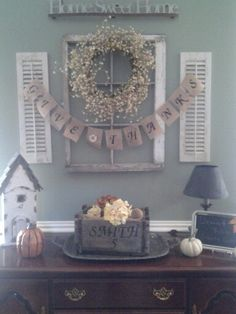 Love to do this to my entryway. With just a few changes.last name of course and a more country distressed table.beautuful