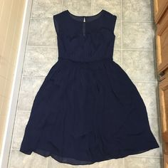 Boden Size 8 Navy cocktail dress Brand New with tags Boden size 8 cocktail dress navy blue with sweetheart neckline leading to sheer fabric neck and shoulder cover. 40 1/2 inches long Boden Dresses Midi