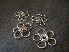 An Array of Wire Flowers by Opal M. Kiehm, via Flickr