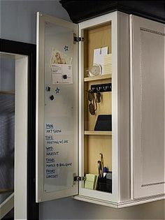 end of cabinet door with magnetic white board inside and hooks for keys, sunglasses and odds and ends! Key Storage, Cupboard Storage, Secret Storage, Hidden Storage, Extra Storage, Small Storage, Diy Kitchen Storage, Storage Cabinets, Locker Storage