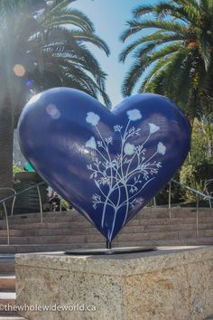 THE  ICONIC HEARTS OF SAN FRANCISCO. THIS ONE IS DARK BLUE WITH FLOWERS ON IT.