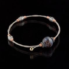 cool jewelry made from guitar strings--www.sixstringjewelry.com