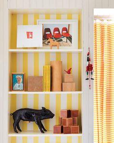 i love the idea of putting wallpaper on the back of bookshelves.