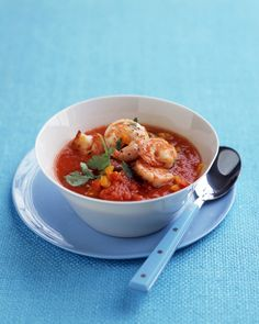 Gazpacho is traditionally made by adding olive oil to the vegetable puree. This version of the Spanish soup only uses a small amount of oil amount to cook the shrimp, reducing fat and calories.