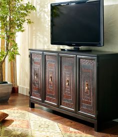 The exclusive Pier 1 Terracotta Low Cabinet is named for its colorful hand-applied detailing