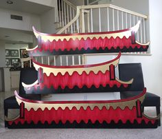 Magalie Sarnataro's props. Asian gate roof ( 8ft and 6.5 ft) foam board cutout,  black, red and gold paint. Will be outlined with LED lights  Asian themed party