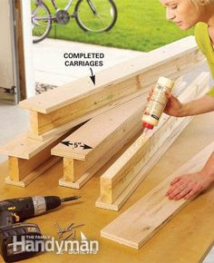Create a Sliding Storage System On the Garage Ceiling - Step by Step: The Family Handyman Workshop Storage, Garage Workshop, Tool Storage, Storage Ideas, Smart Storage, Storage Tubs, Do It Yourself Organization, Garage Organization, Workshop Organization