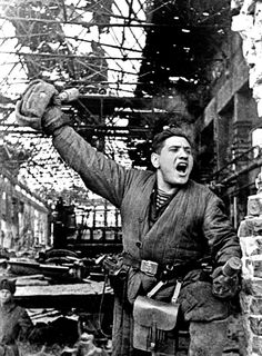A Soviet soldier holding two RGD-33 stick grenades leads an advance on German positions from the ruins of a factory during the Battle of Stalingrad 1942 [1200x1500]