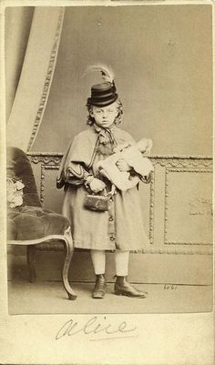 Antique photo of little girl (Alice) and doll; love the hat and purse! Circa 1870 - 1890.