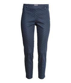 Ankle-length cigarette trousers in a stretch weave with a regular waist, concealed zip in one side, fake pocket at the back and slim legs with slits at the