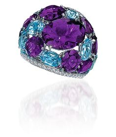 Amethyst & Blue Topaz Dome Ring;  Oval-shaped amethysts and blue topaz are bordered by rows of round brilliant diamonds, in 18-karat white gold.  Cellini Jewelers