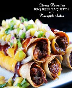 Cheesy Hawaiian BBQ Beef Taquitos & Pineapple Salsa - Beef smothered in spicy, sweet, smoky barbecue sauce, mixed with cheddar cheese, then rolled in a tortilla and broiled to crispy perfection then topped with pineapple salsa.  AMAZING!