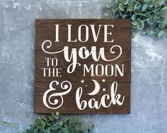 "I love you to the moon and back sign : I'm pretty sure this quote originates from the children's book ""Guess How Much I Love You"". At the end of the book Big Nutbrown Hare whispers to Little Nutbrown"