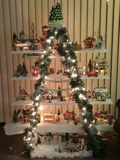 Great way to display your Snow Village in a small space. So easy to make with a ladder, some shelves, snow, garland n lights.