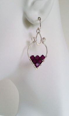 Fall 2012 // Dionysis Earrings Amethyst / by MistyEvansDesign. I just got some cube beads that might be nice in a design like this. Maybe to fill the lower segment of a heart? Wire Jewelry Earrings, Wire Wrapped Earrings, Metal Jewelry, Beaded Earrings, Earrings Handmade, Beaded Jewelry, Jewelery, Jewelry Crafts, Jewelry Ideas