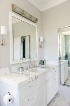 The overhead sconce and the large chrome wall medicine cabinet are nice.
